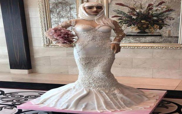 بالصور| كعكة على شكل عروسة في دبي بمليون دولار