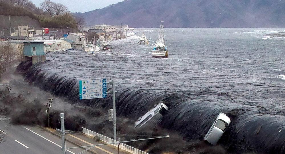 ضربات الشمس والفيضانات تضرب اليابان