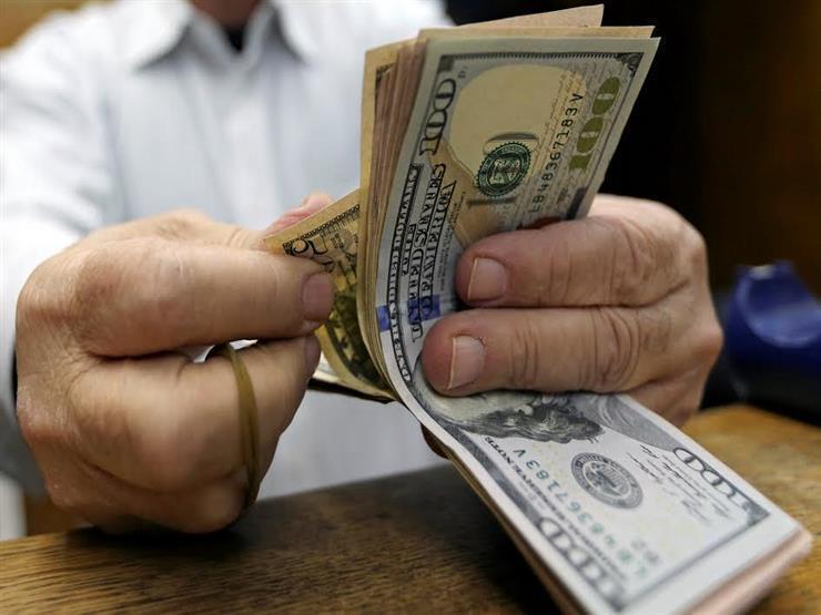 """سعر الدولار الآن في البنوك بعد قرار المركزي إلغاء آلية """"تحويل أموال الأجانب"""""""
