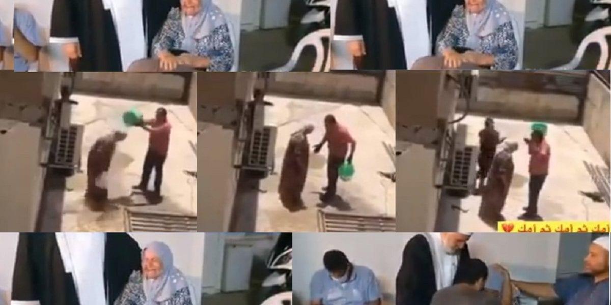 """بالفيديو """"امشي من هنا يلا"""" شاب يعتدي على أمه بالسب والضرب في الشارع ويغرقها بالماء وهذا ما حدث في النهاية"""