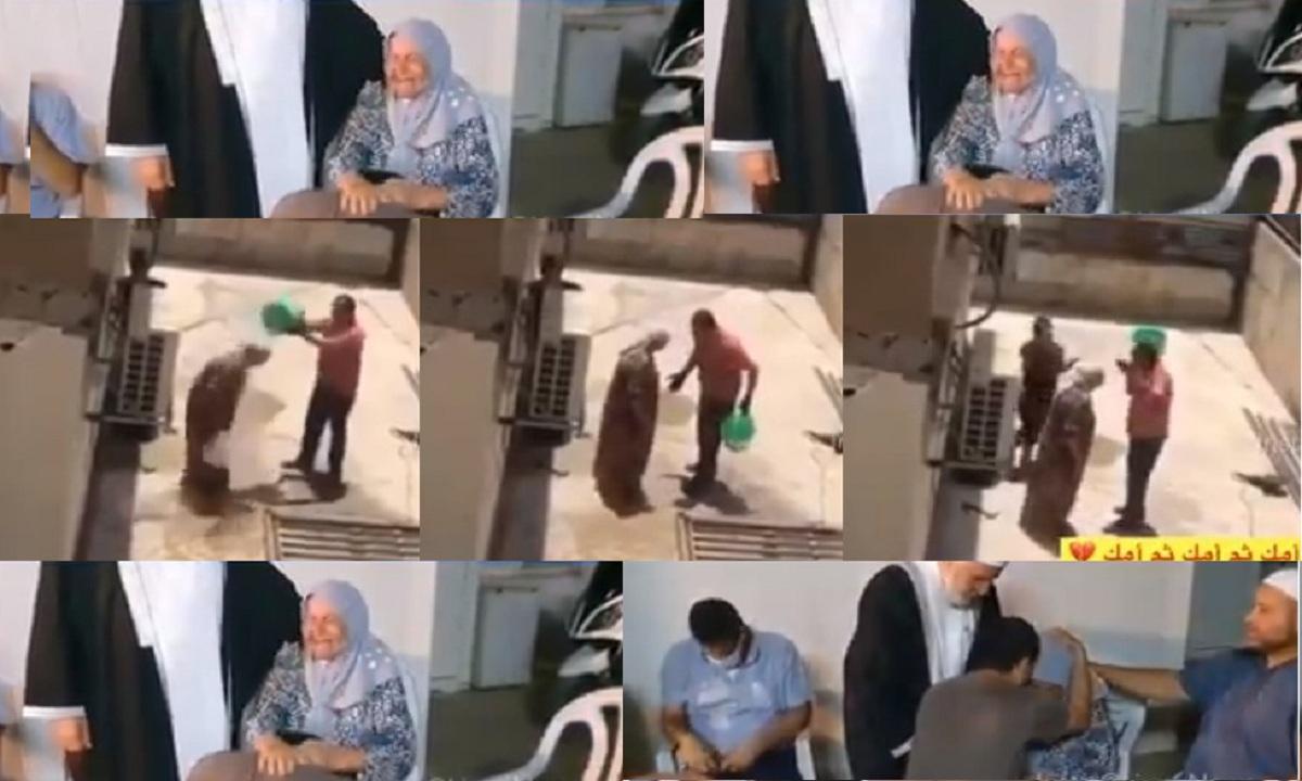 """بالفيديو """"امشي من هنا يلا"""" شاب يعتدي على أمه بالسب والضرب في الشارع ويغرقها بالماء وهذا ما حدث في النهاية 1"""